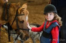 Image of Girl stroking pony