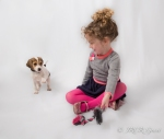 Girl plays with beagle puppy