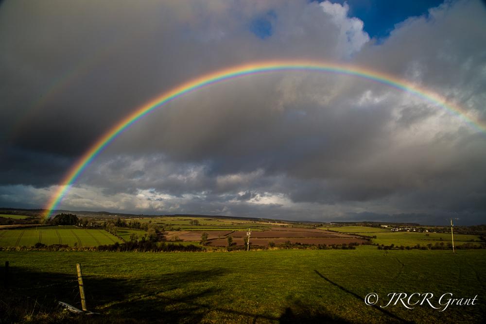 A rainbow firmly plants itself in the fields of East Cork