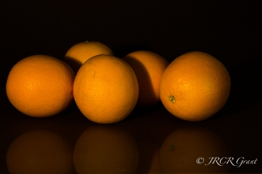 Oranges waiting in the shadows
