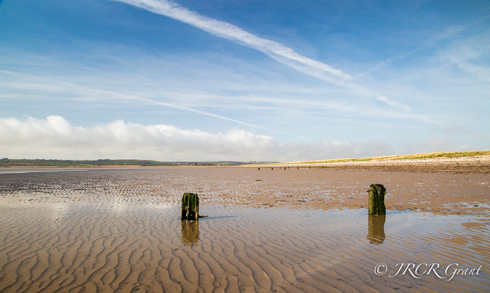 Beach with posts and ripples