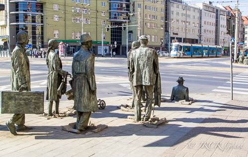 Statues of the Passage installation in Wroclaw disappear into the pavement