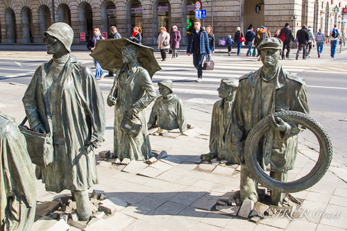Statues rise up out of the pavement