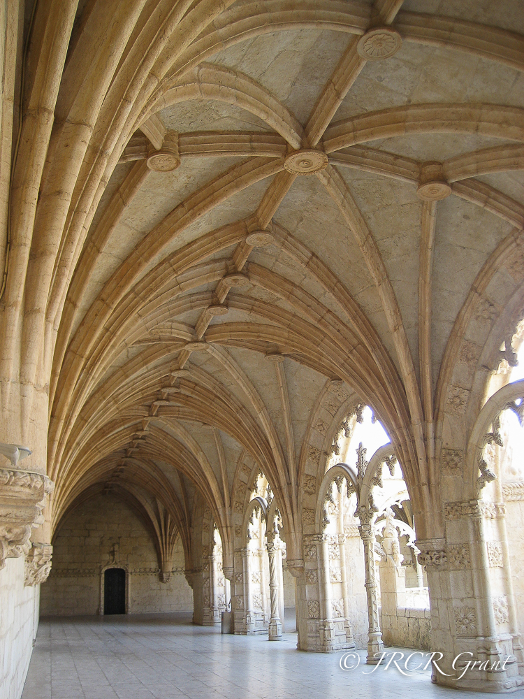 A door stands below the vaulted ceilings of teh cloisters in Jeronimos Monastery, Lisbon