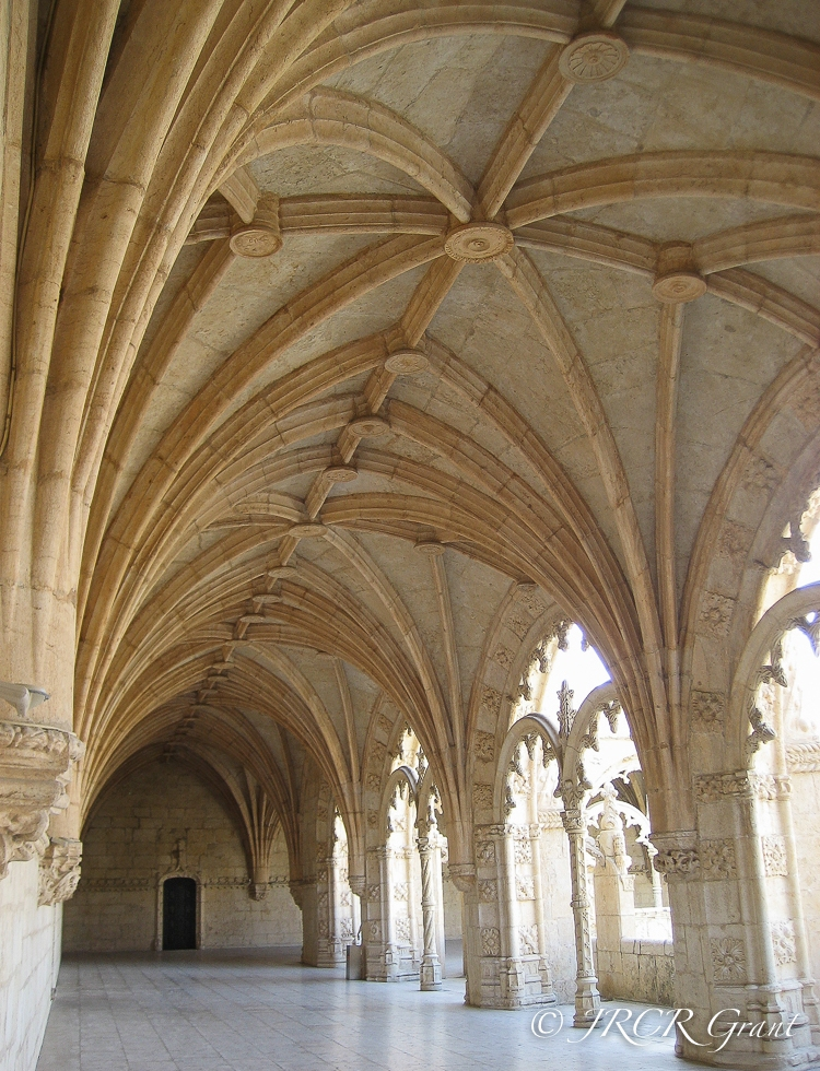 A door stands below the vaulted ceilings of teh cloisters in Jeronimos Monastery, Lisbon