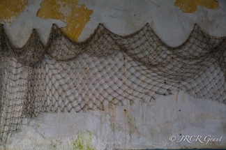 An old fishing net hangs on the wall of Whiddy Island School
