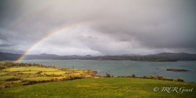 A rainbow emerges over Bantry Bay and Glengarriff, West Cork