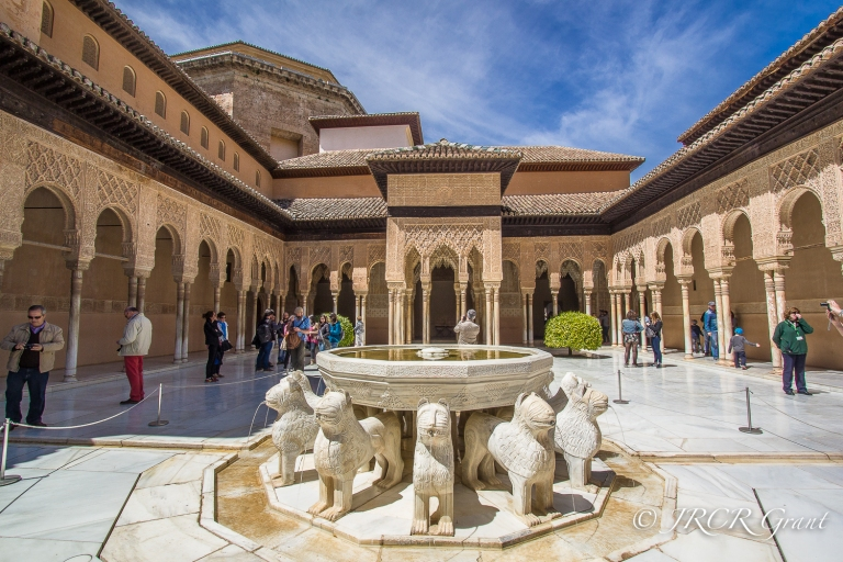Intricate arches surround a courtyard palace