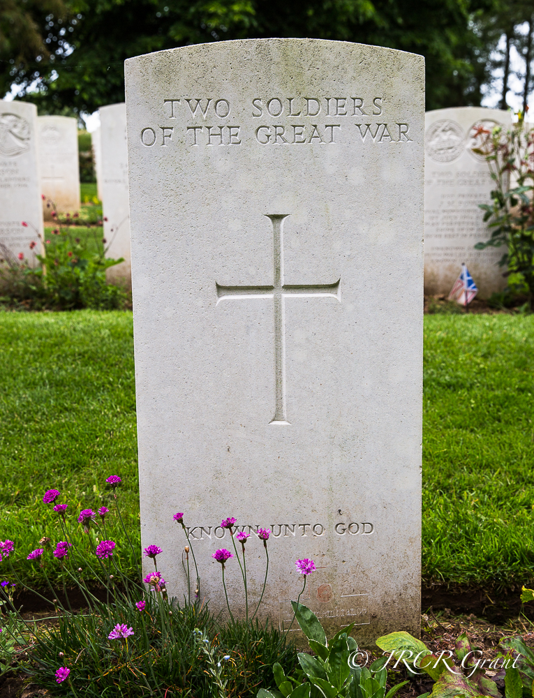 A head stone marks the grave of two unknown soldiers of the great war