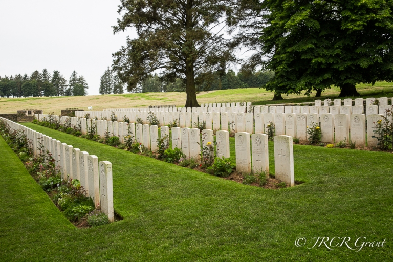 Y-Trench Cemetery with the scarred battlefield behind