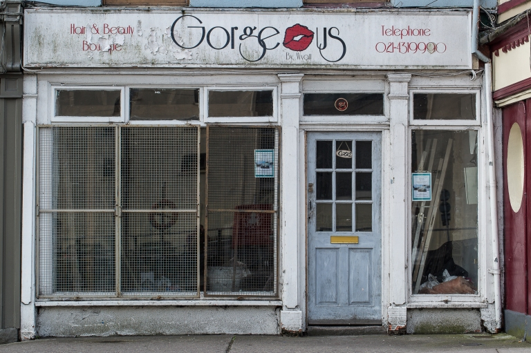 A decayed shop window with Gorgeous emblazoned across the top of the salon frontage