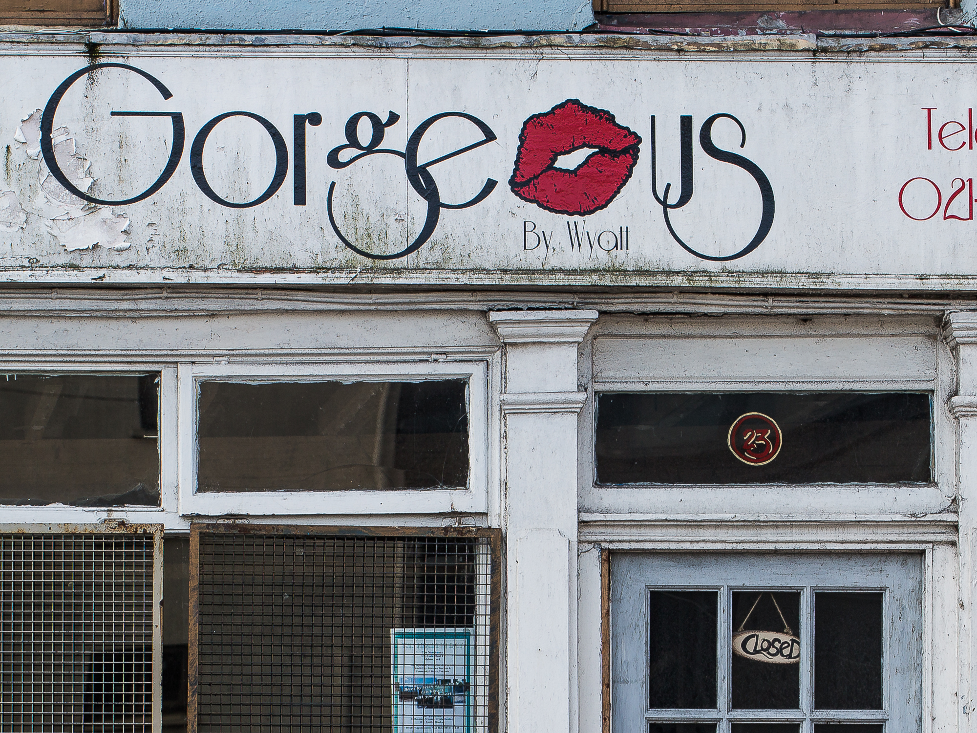A run down beauty boutique has the ironic name of Gorgeous.