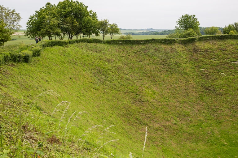 Two people on the edge of the Lochnagar Crater, underline the scale of it all.