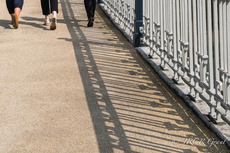3 ladies cross Brian Boru bridge in Cork City centre