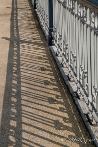 Railings of Brian Boru Bridge in Cork get enhanced by their shadows