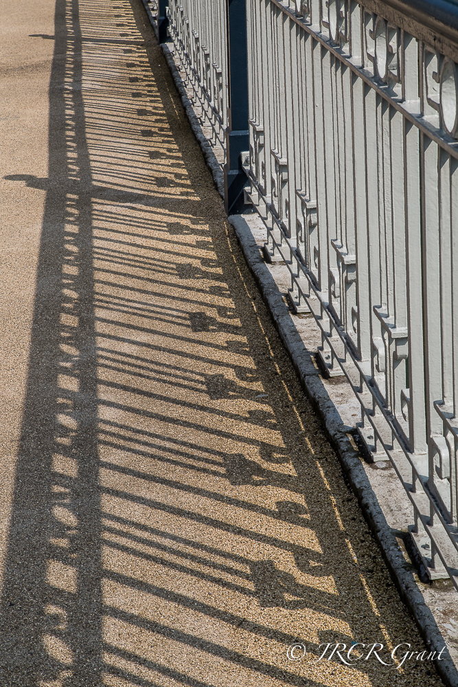 Railings of Brian Boru Bridge in Cork get enhanced by their shadows