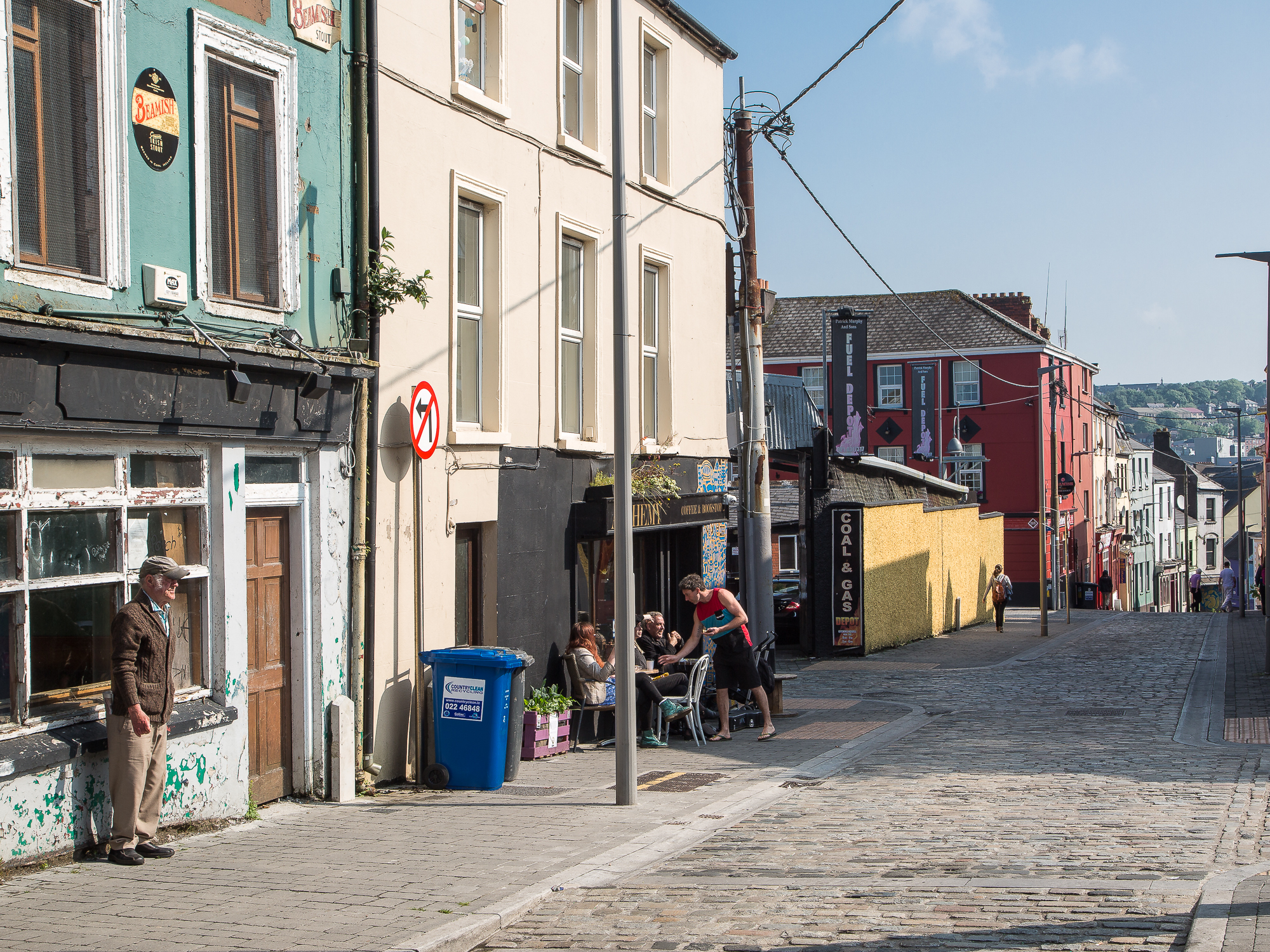 the cobbles of Barrack street plunge down to Cork City centre