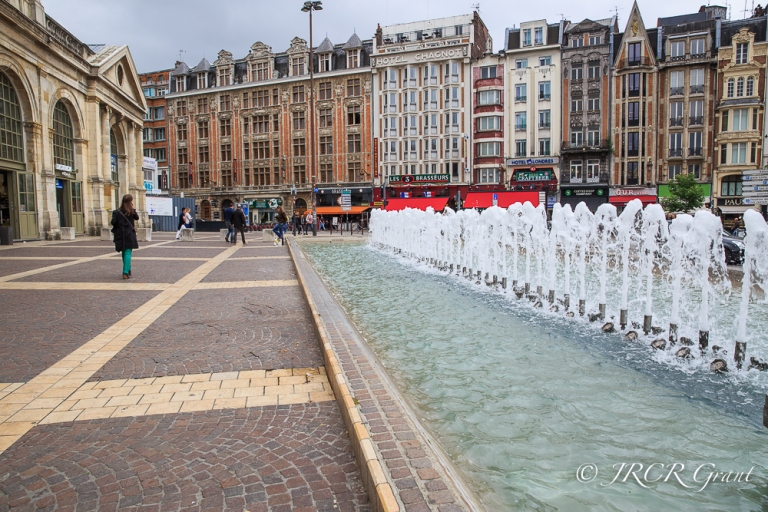 Colourful Place de Gare with fountains in the foreground, Lille