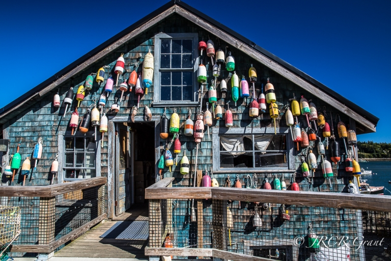 Maine fishing building adorned with colourful fishing floats