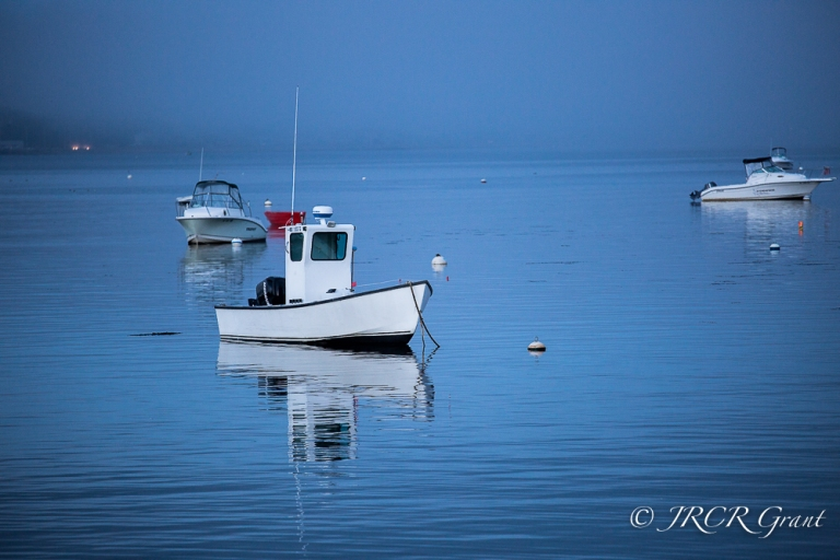 A boat lies in the bay of Provincetown, Cape Cod, MA