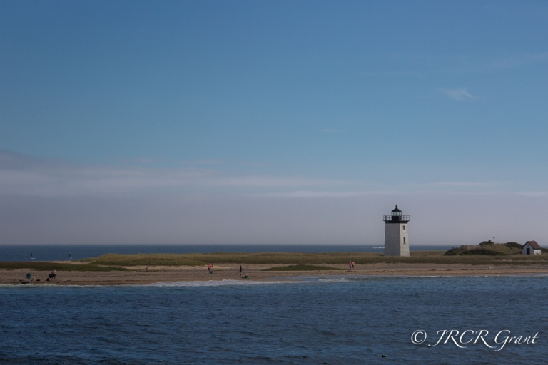 Lighthouse on Cape Cod, backed by a bank of fog