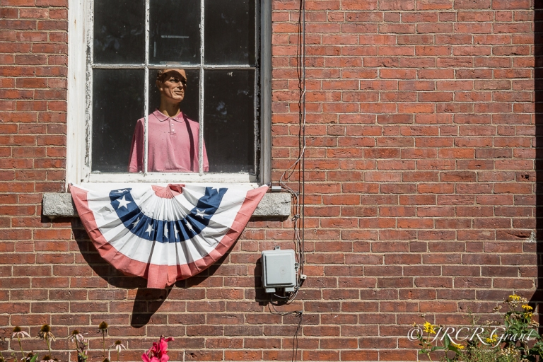 Mannequin at a window in Chester, Vermont