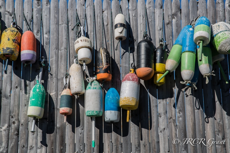 Fishing Floats hang on a dockside fence, Maine, New England