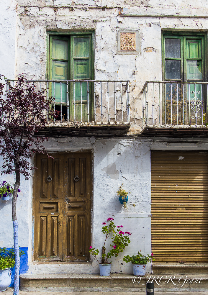 The fading facade of a house in the centre of Lanjarón, Las Alpujarras, Spain