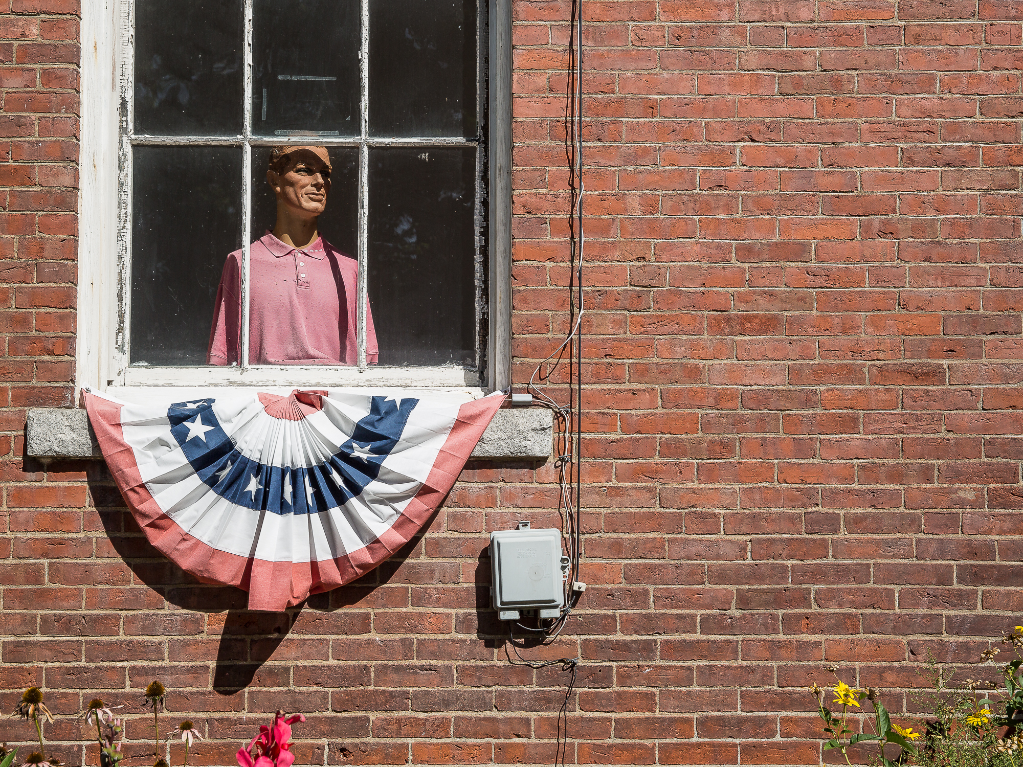 Dummy in Chester, Vermont stares out of a window