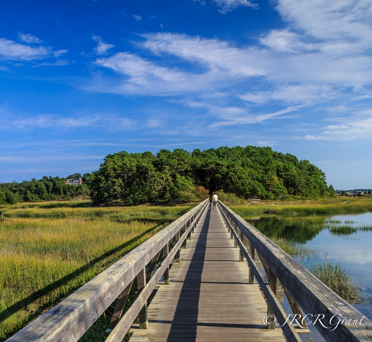 A wooden bridge links the village of Wellfleet, Cape Cod to the other side of the estuary