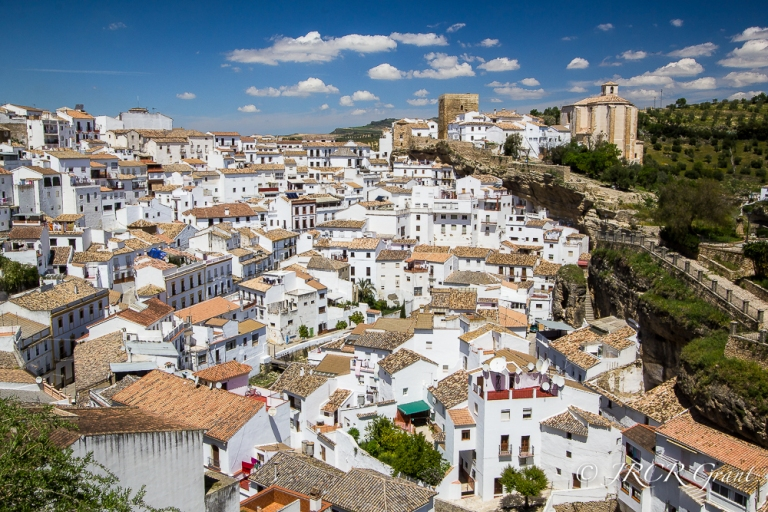 Setenil de las Bodegas crowded into the rocky valley