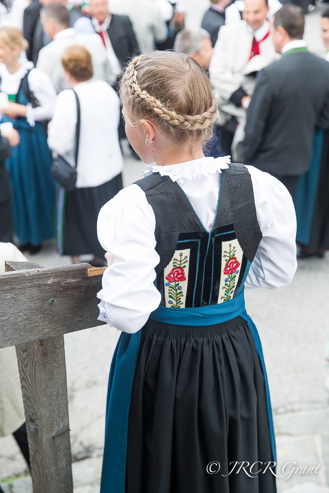 A young lady in the village of Alpbach wearing traditional dress