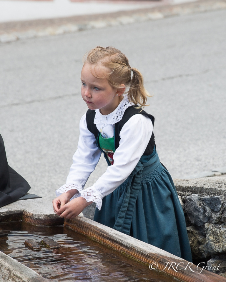 Young Austrian lady in traditional dress in the village of Alpbach, Tyrol, Austria