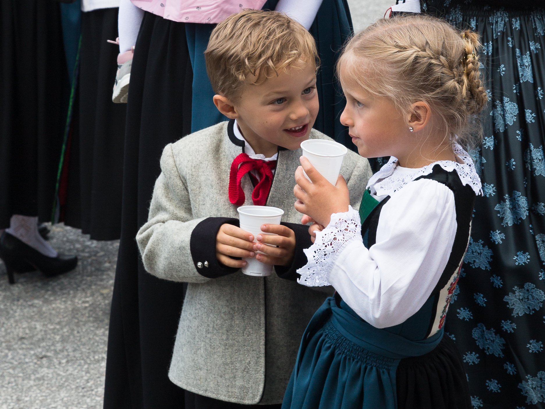 Two young Austrians in traditional dress, Alpbach, Tyrol, Austria