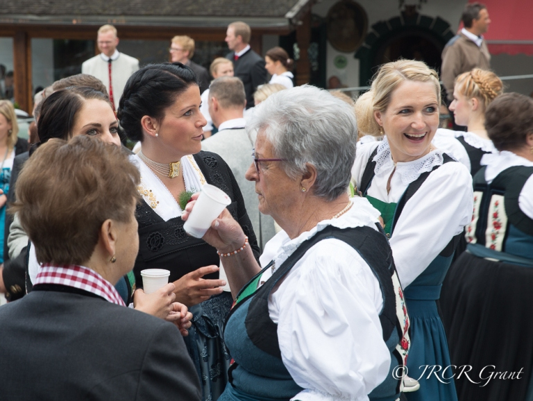 A gathering of locals in traditional Austrian dress