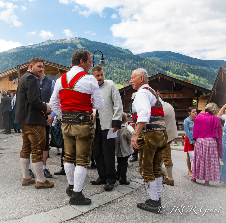 Men in traditional Austrian gear in the village of Alpbach