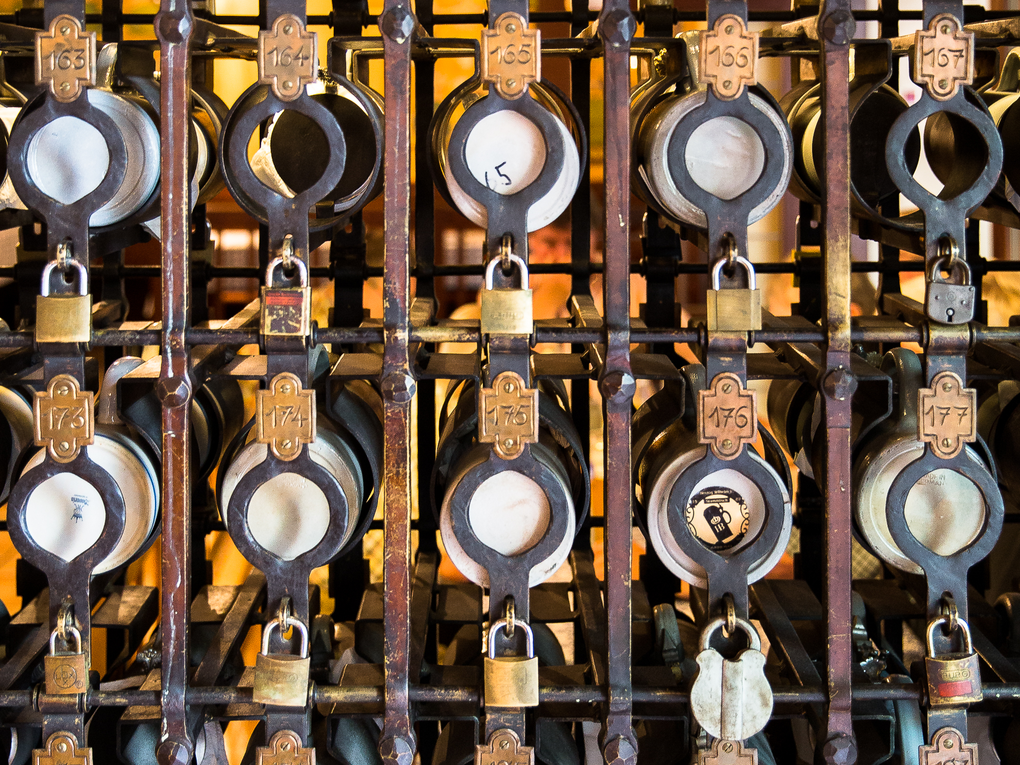 Beer steins under lock and key in a beer hall, munich, bavaria, germany