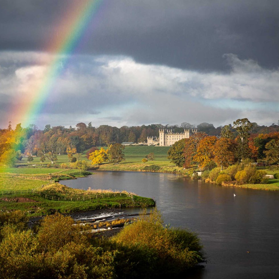 Floors Castle flanked by a rainbow