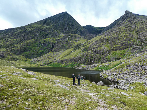 The peak of Carrauntoohil, visible for a fleeting glance, can be seen above Lough Gouragh.