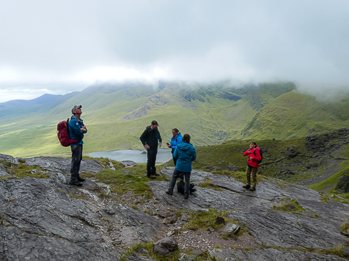 Clouds roll in as the route to Raven's Gully is reviewed