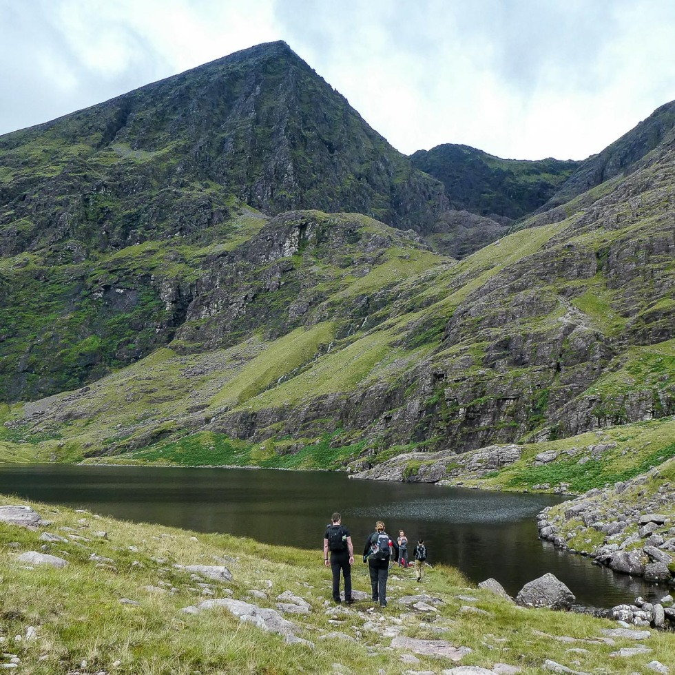 The might of Carrauntoohil stands proud behind Lough Gouragh