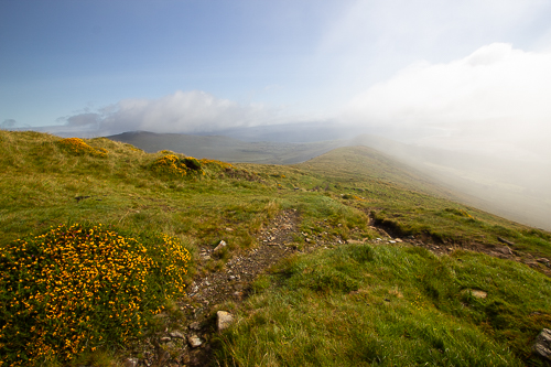 Clouds move over the ridge of the ascent, removing the view along the Tralee coast
