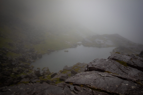 A mountain lough soon disappears in the thick cloud