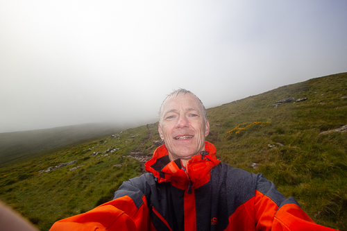 An image of the author with dense cloud obscuring the summit of Mount Brandon