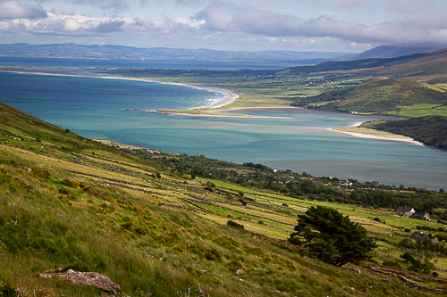 A patchwork of fields and the sea close to shore provide innumerable shades of blue and green on the Dingle Peninsula, Kerry, Ireland