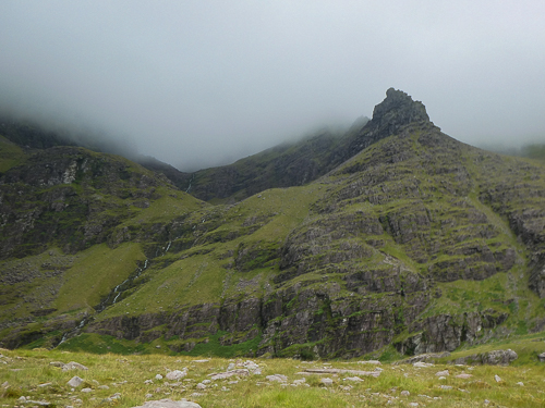 A blanket of cloud wraps itself around the upper reaches of Carrauntoohil