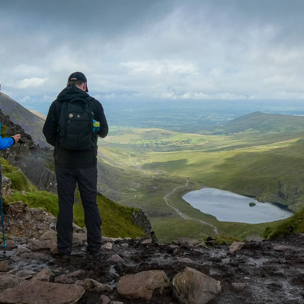 Two hikers take in the view from the top of the Devil's Ladder on Carrauntoohil