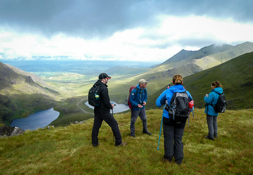 Dark clouds roll on overhead as the group gathers to enjoy the view from the top of the Devil's Ladder.
