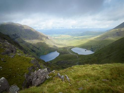 From the top of the Devil's Ladder an impressive view is gained of the two loughs in Hag's Glen and beyond to the Kerry plains.
